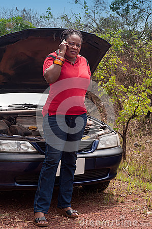 Car breakdown - African American woman call for help, road assistance.