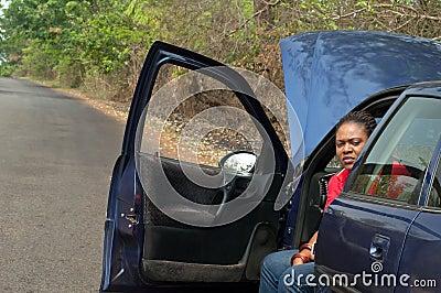 Car breakdown - African American woman wait for he
