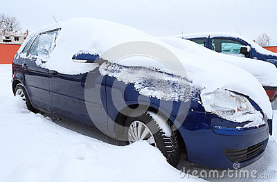 Car covered by heavy snow