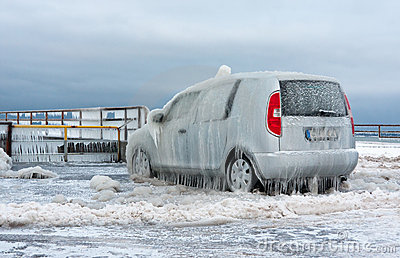 A car covered with ice layer