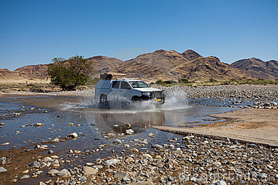 Car crossing river