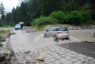 Car crossing a road flooded Editorial Stock Photo