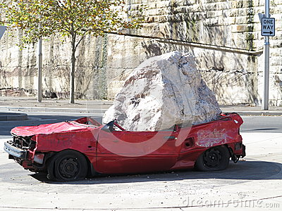 Car crushed by rock