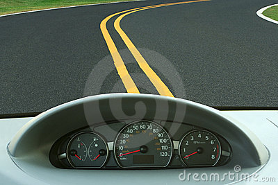 Car dashboard and curvy road