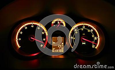 Car dashboard dials at night