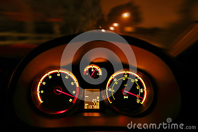 Car dashboard dials at night