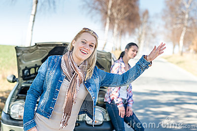 Car defect two women wait for help