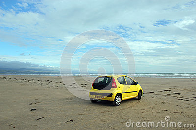 Car on a deserted beach.