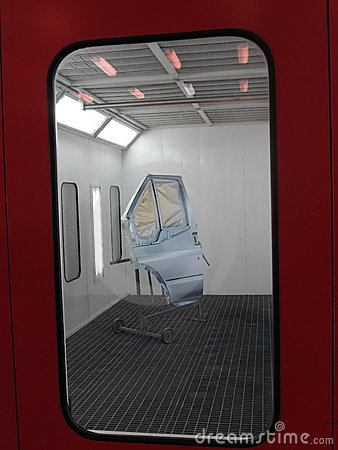 the image of a painted car door stands in a spray booth. Black Bedroom Furniture Sets. Home Design Ideas