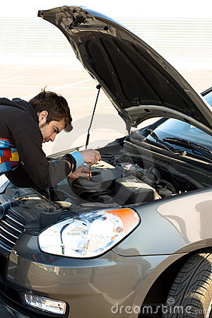 Car driver examining the car s engine