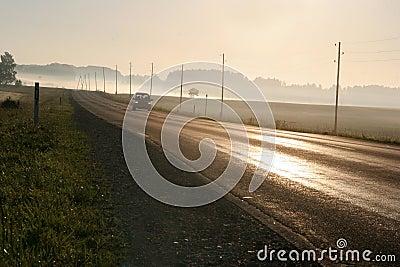 Car driving along foggy road