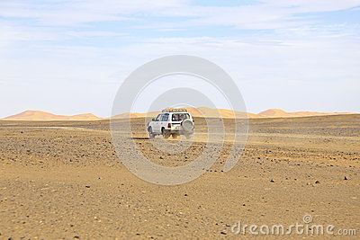 Car driving in the Erg Chebbi desert in Morocco