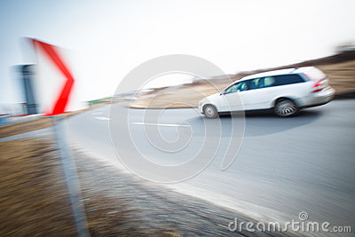 Car driving fast through a sharp turn