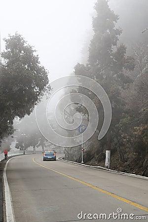 Car driving in heavy fog