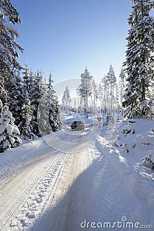 Car driving through snowy winter
