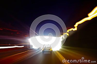 Car exiting a dark tunnel