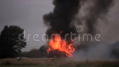 Car Explosion. An old European saloon car destroyed in a controlled explosion