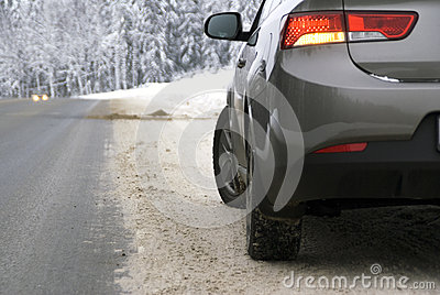 Car on the forest road in winter