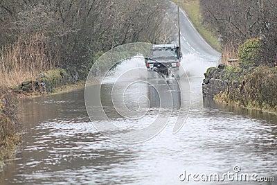 Car Going Through Flood