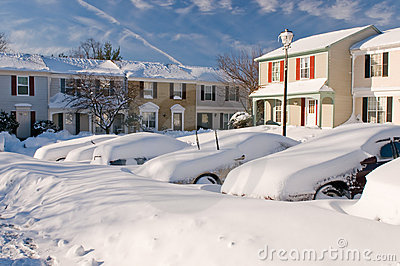Car and houses after snowstorm