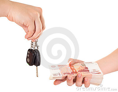 Car key in hand and cash money
