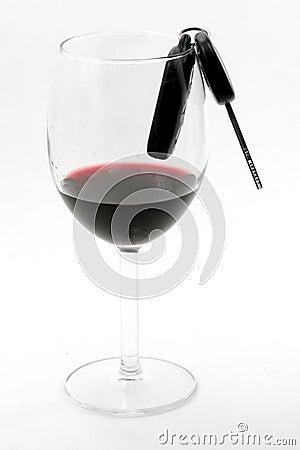 Car key in a wine glass, drunk driver