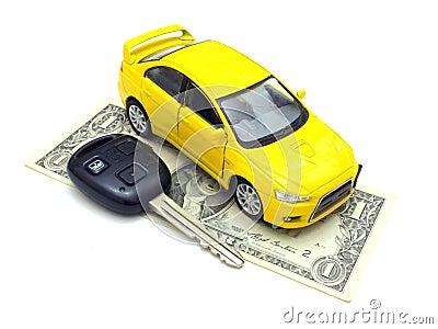 Car keys and car at background