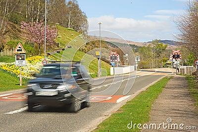 Car leaving level crossing.
