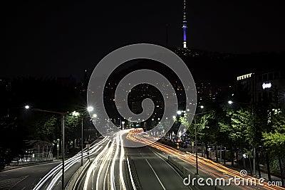 Car lights trailing.