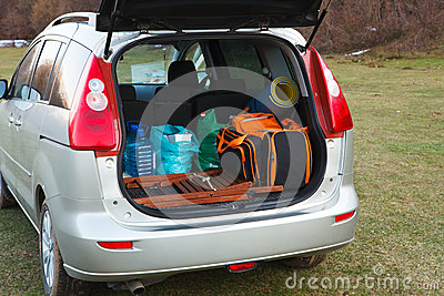 Car loaded with open trunk and luggage