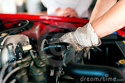 Car mechanic in repair shop