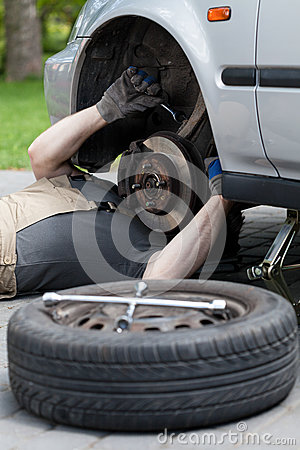 Car mechanic during work