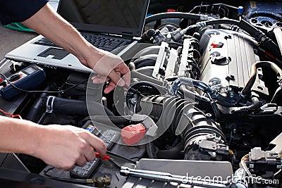 Car mechanic working in auto repair service. Stock Photo