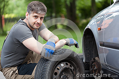Car mechanic working outdoors