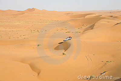 A car in the middle of sand dunes