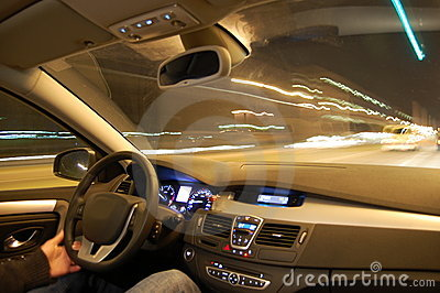Car in motion at night