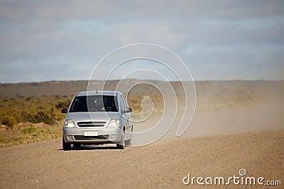 Car on an open dusty road