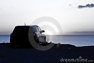 Car parked overlooking sunset