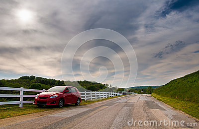 Car parked on the side of a backroad in Southern York County, Pe