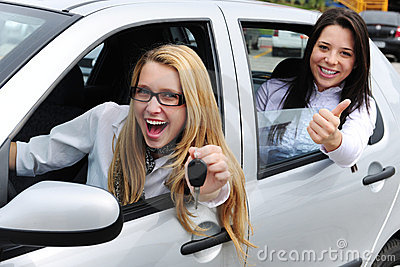 Car rental: women driving a car