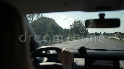 Car riding on highway in sunlight stock footage