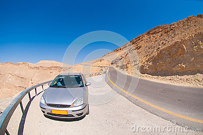 Car on the road in the desert