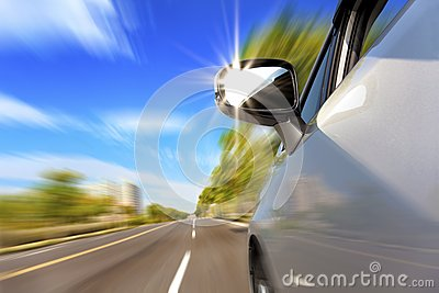 Car on the road with motion blur