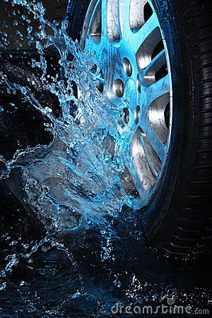 Car s wheel  with blue water
