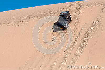 Car sliding down a dune