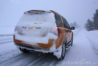 Car with snow on winter road