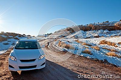 Car in snowy desert
