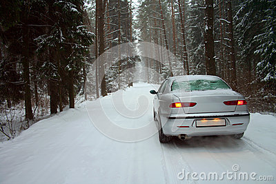 Car in a snowy winter forest