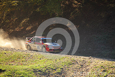 Car speeding on dust gravel Editorial Stock Image