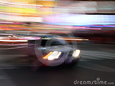 Car speeds through Times Square, New York City